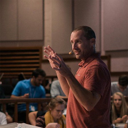 A youth pastor addresses a group of Precept students